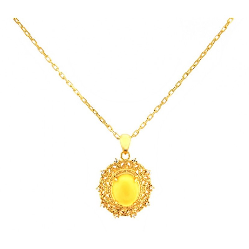 Piękny naszyjnik ze srebra pozłoconego 24 karatowym złotem  z zawieszka z cyrkoniami i naturalnym bursztynem mlecznym.