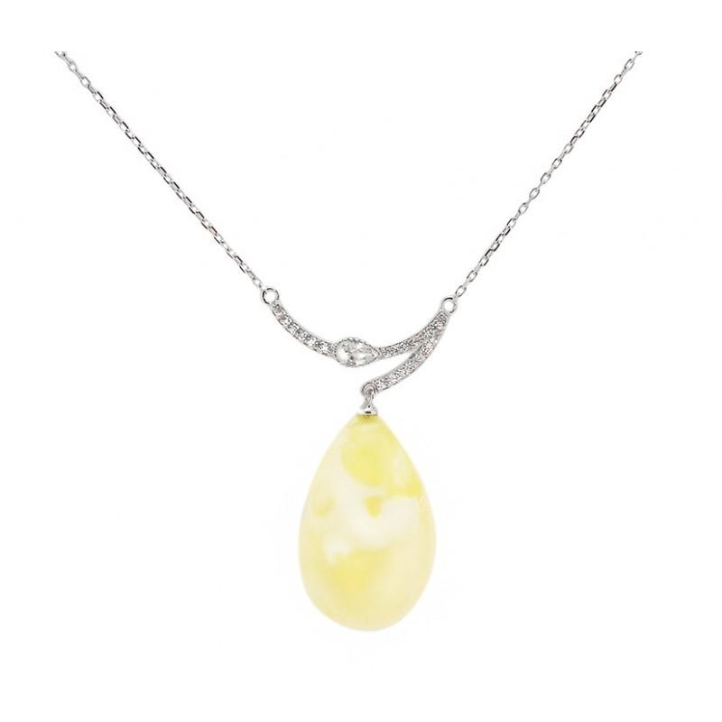 Naszyjnik ze srebra pozłacany 24 karatowym złotem z cyrkoniami i  naturalnym dużym wiszącym bursztynem w mlecznym kolorze.