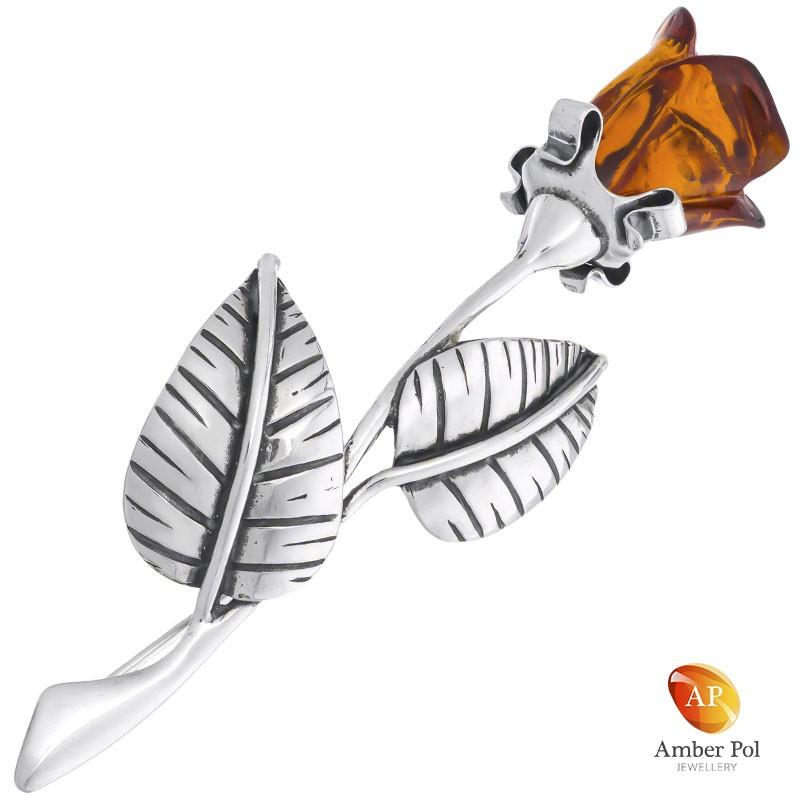 Broszka srebrna z bursztynem w kształcie róży. Bursztyn w kolorze koniaku.
