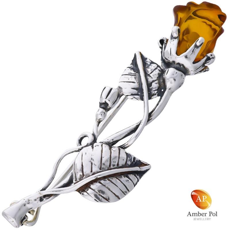 Broszka srebrna 925 z bursztynem oszlifowanym w kwiat róży w kolorze  koniaku. Łodyżka srebrna z dwoma listkami i jednym pąkiem.