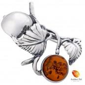 Broszka srebrna 925 z koniakowym bursztynem.  Kształt gałązki z owocami.