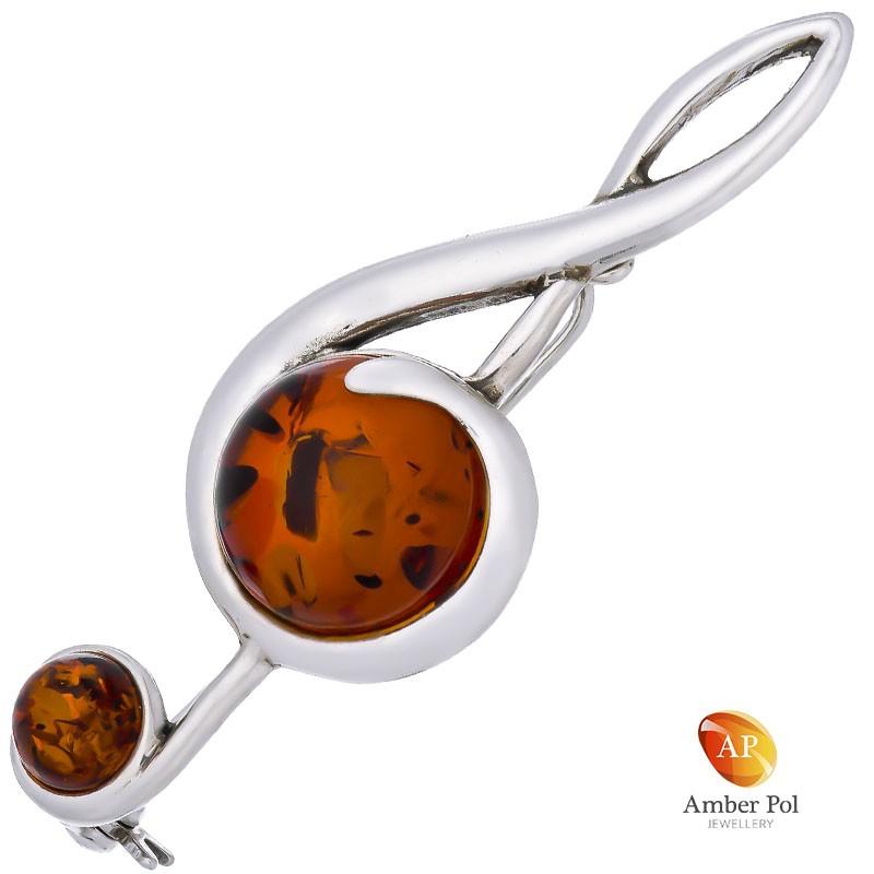 Broszka srebrna 925 z bursztynem w kolorze koniaku o kształcie klucza wiolinowego.