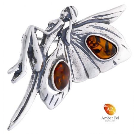 Broszka srebrna 925 z bursztynem w kolorze koniaku o kształcie kobiecego elfa ze skrzydłami jak motyl.
