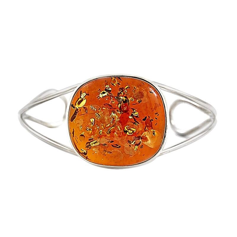 Piękna bransoletka wykonana całkowicie ręcznie ze srebra 925 z dużym bursztynem w koniakowym kolorze.