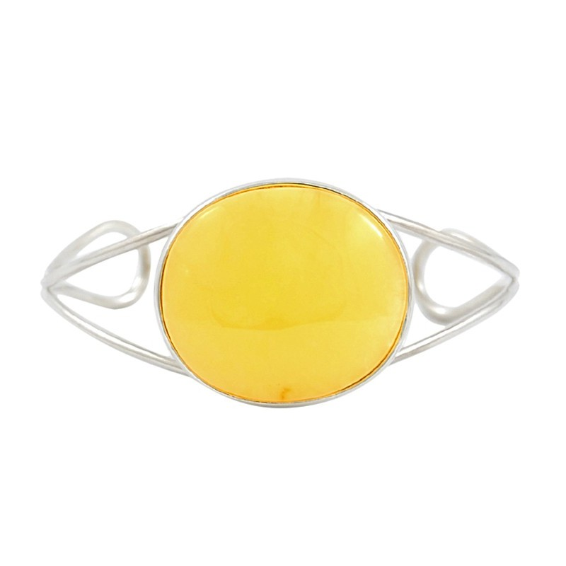 Unikatowa bransoletka wykonana ze srebra próby 925 z dużym naturalnym bursztynem w mlecznym kolorze.