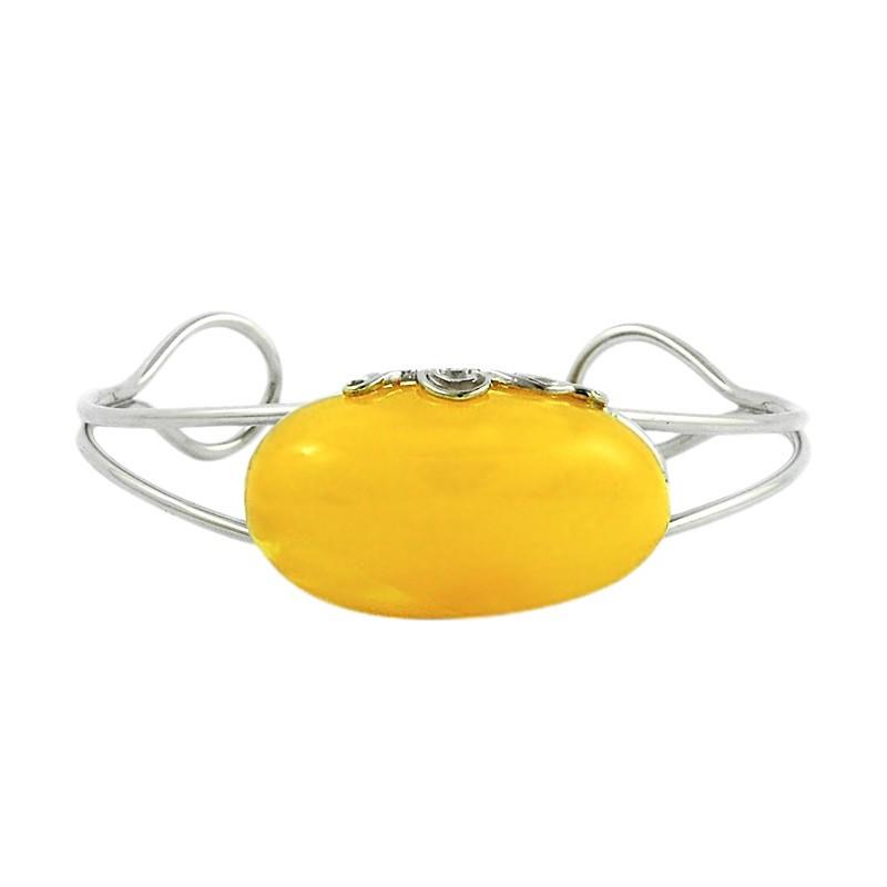 Piękna bransoletka wykonana w całości ręcznie ze srebra 925 i dużym bursztynem w mlecznym kolorze.