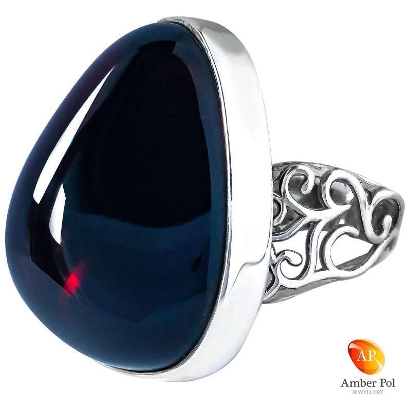 Unikatowy pierścionek ze srebra 925 z pięknym wiśniowym bursztynem z ażurowa obrączką.