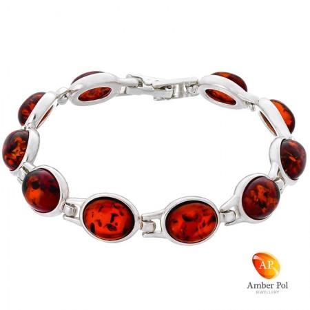 Piękna bransoletka ze srebra próby 925 składająca się z 10 elementów z owalnymi bursztynami w kolorze koniakowym.