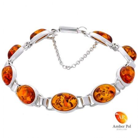 Piękna bransoletka ze srebra próby 925 składająca się z 9 elementów z owalnymi bursztynami w kolorze koniakowym.