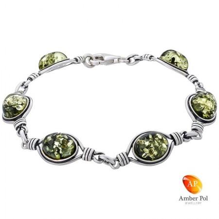 Piękna srebrna bransoletka próby 925 z 6 elementami i zielonymi bursztynami. Posiada dodatkowe zdobienie w kształcie pętelki.