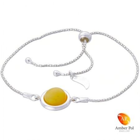 Bransoletka srebrna 925 ściągana i regulowana z  okrągłym bursztynem w białym kolorze.