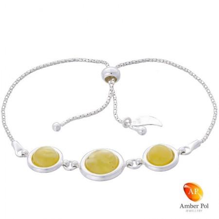 Bransoletka srebrna 925 ściągana i regulowana z  trzema okrągłymi bursztynami  w mlecznym  kolorze.
