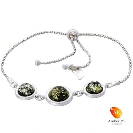 Bransoletka srebrna 925 ściągana i regulowana z  trzema okrągłymi bursztynami  w zielonym  kolorze.